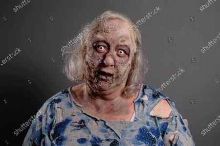 Jackie Weaver, who became an internet sensation during a meeting of Handforth Parish Council, unveils a deadly make-up look inspired by 'The Walking Dead', to launch a new bookable service that allows weary workers and fans to hire a member of the living dead to take their place during a video call.