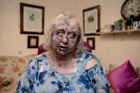 Stock Picture of Jackie Weaver, who became an internet sensation during a meeting of Handforth Parish Council, unveils a deadly make-up look inspired by 'The Walking Dead', to launch a new bookable service that allows weary workers and fans to hire a member of the living dead to take their place during a video call