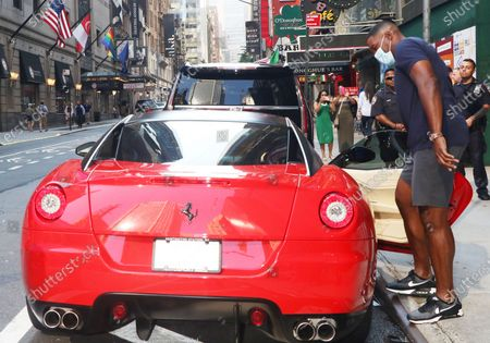 Michael Strahan seen by his Ferrari after exiting ABC studios in New York City
