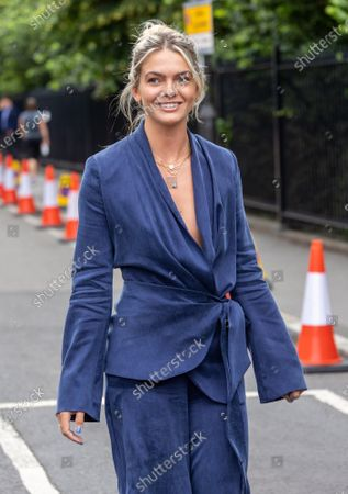 Murray fan and celeb Louisa Johnson arrives at Wimbledon to see Andy Murray play his second round match against German Oscar Otte on Centre Court today on the third day of the Championships. The 2021 AELTC Tennis Championships at Wimbledon, southwest London is back for the first time in two years after it was cancelled last year due to the Covid-19 pandemic. However, capacity is down by 50% and fans must pre-ordered tickets with no overnight camping.
