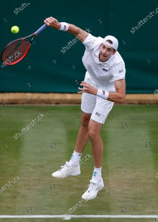John Isner of the United States serves to Japan's Yoshihito Nishioka during the men's singles first round match on day three of the Wimbledon Tennis Championships in London
