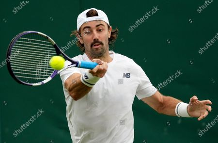 Australia's Jordan Thompson plays a return to Norway's Casper Ruud during the men's singles first round match on day three of the Wimbledon Tennis Championships in London