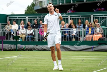 Norway's Casper Ruud gestures during the men's singles first round match against Australia's Jordan Thompson on day three of the Wimbledon Tennis Championships in London