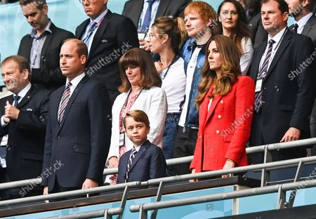 Prince William, Catherine Duchess of Cambridge and Prince George. With Ed Sheeran in the background