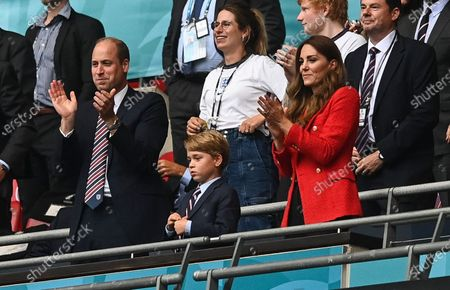Prince William, Catherine Duchess of Cambridge and Prince George celebrate following a goal from Sterling of England 1-0.