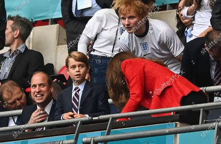 Prince William, Catherine Duchess of Cambridge and Prince George celebrate following a goal from Sterling of England 1-0. With Ed Sheeran in the background