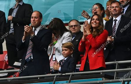 Prince William, Catherine Duchess of Cambridge and Prince George celebrate following a goal from Sterling of England 1-0
