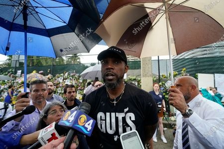 Miami Heat Forward Udonis Haslem speaks to journalists after visiting a makeshift memorial to the scores of people who were killed or remain missing nearly a week after the partial collapse of the Champlain Towers South condo building, in Surfside, Fla