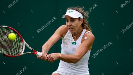 Romania's Mihaela Buzarnescu plays a return to Venus Williams of the US during the women's singles first round match on day two of the Wimbledon Tennis Championships in London