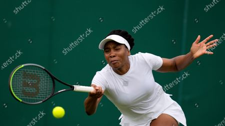 Venus Williams of the US plays a return to Romania's Mihaela Buzarnescu during the women's singles first round match on day two of the Wimbledon Tennis Championships in London