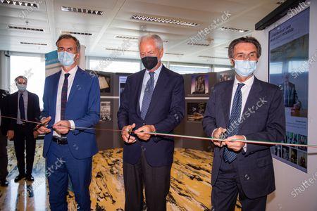 """Stock Image of Attilio Fontana, Marco Tronchetti Provera and Alessandro Fermi attend """"60 Years Of Pirellone"""" exhibition press conference at Palazzo Pirelli on June 29, 2021 in Milan, Italy."""