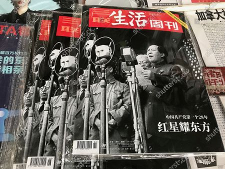 A government magazine features a front-page story on former Chairman Mao Zedong as the country commemorates the 100th anniversary of China's Communist Party in Beijing, on Wednesday, June 30, 2021.  China is marking the centenary of its ruling Communist Party this week by heralding what it says is its growing influence abroad, along with success in battling corruption and poverty at home.