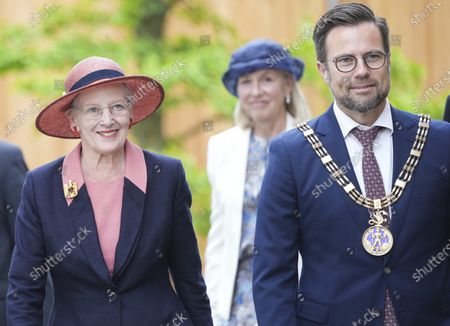 Stock Photo of Queen Margrethe II of Denmark arrives with mayor of Odense, Peter Rahbaek Juel to open the new H.C. Andersen Hus in Odense, Denmark, 30 June 2021. The new Hans Christian Andersen Museum celebrates the author of fairy tales like 'The Little Mermaid', who was born in Odense in 1805.