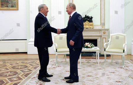 Stock Picture of Russian President Vladimir Putin (R) and former Kazakh President Nursultan Nazarbayev (L) during their meeting in Moscow, Russia, 30 June 2021.