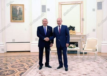 Russian President Vladimir Putin (R) and former Kazakh President Nursultan Nazarbayev (L) during their meeting in Moscow, Russia, 30 June 2021.