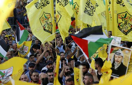 Palestinian supporters Fatah movement take part in a rally in support of Palestinian president Mahmud Abbas in the West Bank city of Nablus on June 30, 2021.
