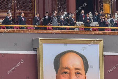 Chinese President Xi Jinping (C) waves above a portrait of former leader Mao Zedong to the crowd from the Forbidden City after his speech at Tiananmen Square during the celebration of 100th founding anniversary of the Chinese Communist Party, in Beijing, China, 01 July 2021. China celebrates on 01 July the 100th anniversary of the founding of the ruling Chinese Communist Party.