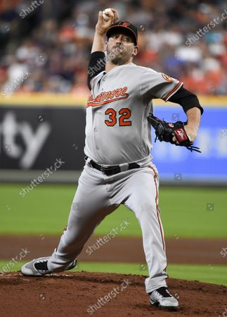 Baltimore Orioles starting pitcher Matt Harvey delivers during the first inning of a baseball game against the Houston Astros, in Houston