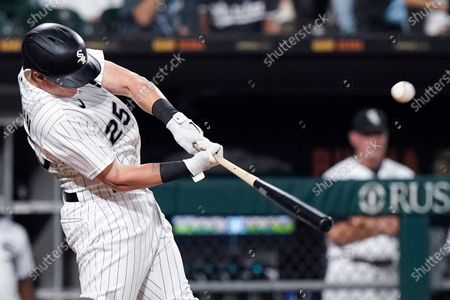 Chicago White Sox's Andrew Vaughn hits a sacrifice fly to Minnesota Twins center fielder Nick Gordon during the fourth inning of a baseball game in Chicago