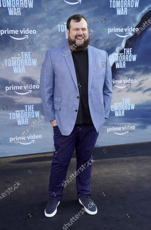 """Mike Mitchell, a cast member in """"The Tomorrow War,"""" poses at the Los Angeles premiere of the film, at Banc of California Stadium"""