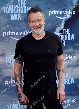 """Chris McKay, director of """"The Tomorrow War,"""" poses at the Los Angeles premiere of the film, at Banc of California Stadium"""