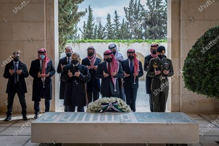 From the Royal Court twitter account, shows Jordan's King Abdullah II, center, Prince Hamzah, second left, and others praying during a visit to the tomb of the late King Hussein, in Amman Jordan. Years of economic crisis have frayed the historic patronage-for-loyalty bond between the king and the tribes, a bedrock of the Hashemite family's decades-long rule. That may have been an underlying factor in an alleged plot by Prince Hamzah, the half brother of King Abdullah II, to try to take a throne he was once in line to inherit