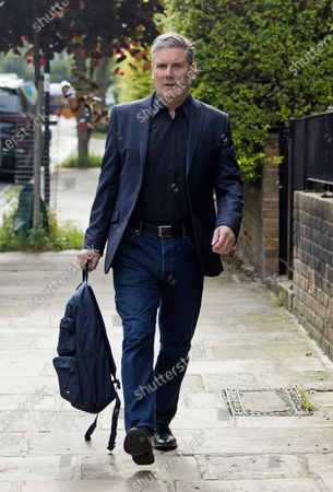 Labour Party leader Sir KEIR STARMER leaves his London home on the morning of the Batley and Spen by-election. Labour are expected to perform badly in the poll, which was called when previous Member of Parliament, Tracy Brabin, was elected mayor of West Yorkshire.