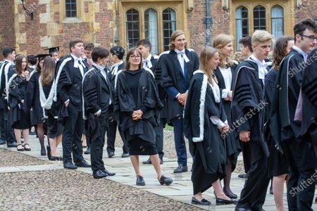 Students from St John's College Cambridge on their graduation day which has returned after the ceremony was cancelled last year due to the Coronavirus pandemic.Students dressed in black gowns as the traditional Cambridge University graduation ceremonies took place - after they were cancelled last year due to the Coronavirus pandemic.The students paraded into historic Senate House to collect their degrees from the prestigious university.Family and friends would normally watch the ceremony inside the Senate House, but this year they had to wait outside due to Covid restrictions. The ceremony was streamed online so guests could watch it over the Internet. Afterwards they were able to join the students for a picnic in the colleges' grounds.This year there were less students at the ceremonies, with some self-isolating and others choosing to attend extra ceremonies later in the year.Many parts of the degree ceremonies have their origin amongst the earliest customs of the university 800 years ago.Undergraduates are required to wear the gown of their college and the hood of the degree they are about to receive.Graduates are presented in the Senate House college by college, in order of foundation or recognition by the university, except for the royal colleges.Mortarboards are optional for Cambridge graduates and if worn they must carry them into the Senate House.
