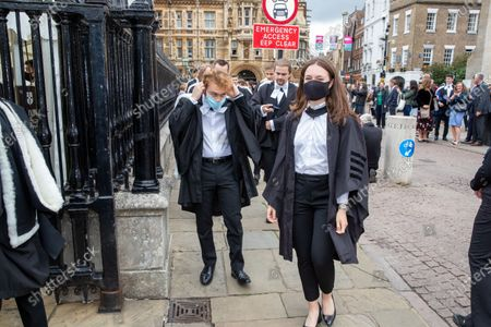 Stock Picture of Students from St John's College Cambridge on their graduation day which has returned after the ceremony was cancelled last year due to the Coronavirus pandemic.Students dressed in black gowns as the traditional Cambridge University graduation ceremonies took place - after they were cancelled last year due to the Coronavirus pandemic.The students paraded into historic Senate House to collect their degrees from the prestigious university.Family and friends would normally watch the ceremony inside the Senate House, but this year they had to wait outside due to Covid restrictions. The ceremony was streamed online so guests could watch it over the Internet. Afterwards they were able to join the students for a picnic in the colleges' grounds.This year there were less students at the ceremonies, with some self-isolating and others choosing to attend extra ceremonies later in the year.Many parts of the degree ceremonies have their origin amongst the earliest customs of the university 800 years ago.Undergraduates are required to wear the gown of their college and the hood of the degree they are about to receive.Graduates are presented in the Senate House college by college, in order of foundation or recognition by the university, except for the royal colleges.Mortarboards are optional for Cambridge graduates and if worn they must carry them into the Senate House.
