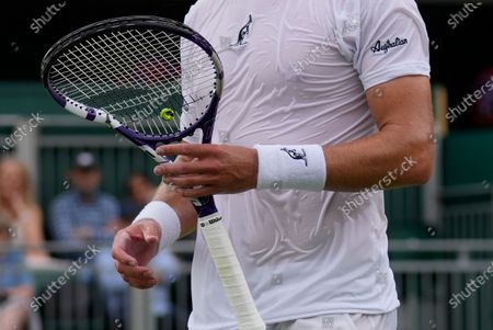 Australia's James Duckworth holds his broken racket during the men's singles second round match against Sam Querrey of the US on day four of the Wimbledon Tennis Championships in London