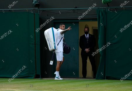 Australia's Nick Kyrgios leaves the court after winning the men's singles second round match against Italy's Gianluca Mager on day four of the Wimbledon Tennis Championships in London