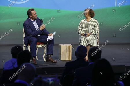 """Stock Photo of Arnold Schwarzenegger, Founder of the Austrian World Summit"""" has a talk on stage with Lisa Jackson, the Sustainability Manager of Apple"""" about her work and the fight of the climate crisis in Vienna, Austria"""