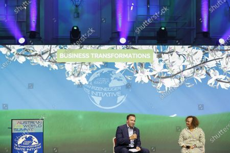 """Stock Image of Arnold Schwarzenegger, Founder of the Austrian World Summit"""" has a talk on stage with Lisa Jackson, the Sustainability Manager of Apple"""" about her work and the fight of the climate crisis in Vienna, Austria"""
