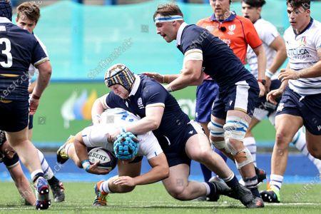 Scotland vs Italy. Italy's Thomas Di Bartolomeo is tackled by Michael Jones of Scotland