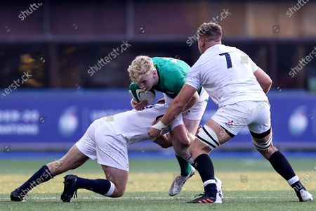 Ireland vs England. Ireland's Jamie Osborne is tackled by Dan Lancaster and Jack Clement of England