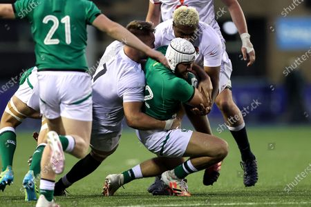 Ireland vs England. Ireland's Ben Carson is tackled by Jack Clement and Tarek Haffar of England