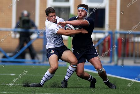 Patrick Harrison of Scotland is tackled by Arturo Fusari of Italy.