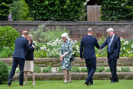 Stock Image of From left, Britain's Prince Harry, Lady Sarah McCorquodale, Lady Jane Fellowes, Prince William and Charles Spencer, greet each other ahead of the unveiling of a statue of Princess Diana, on what woud have been her 60th birthday, in the Sunken Garden at Kensington Palace, London