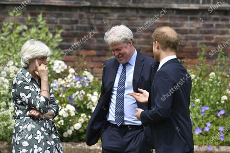 Britain's Prince Harry reacts with his aunt, Lady Jane Fellowes and uncle, Charles Spencer as he and Prince William unveil a statue they commissioned of their mother Princess Diana, on what woud have been her 60th birthday, in the Sunken Garden at Kensington Palace, London