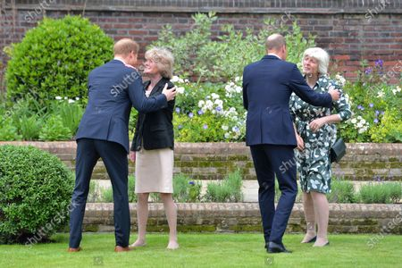 Britain's Prince William, secondright and Prince Harry, left greet their aunts, Lady Sarah McCorquodale, second left and Lady Jane Fellowes, right, as they unveil a statue they commissioned of their mother Princess Diana, on what woud have been her 60th birthday, in the Sunken Garden at Kensington Palace, London