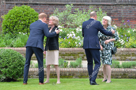 Stock Picture of Prince Harry (left) and Prince William (second right) greet their aunts Lady Sarah McCorquodale (second left) and Lady Jane Fellowes (right) ahead of the unveiling of a statue they commissioned of their mother Diana, Princess of Wales, in the Sunken Garden at Kensington Palace, London, on what would have been her 60th birthday