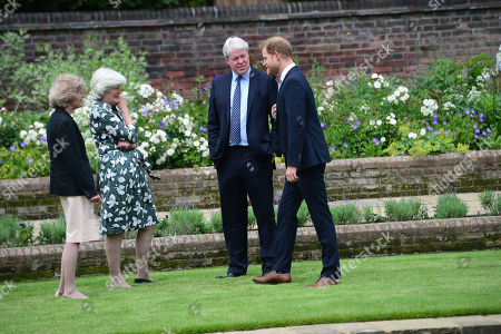 (left to right) Lady Sarah McCorquodale, Lady Jane Fellowes and Earl Spencer, with their nephew Prince Harry during the unveiling of a statue they commissioned of hismother Diana, Princess of Wales, in the Sunken Garden at Kensington Palace, London, on what would have been her 60th birthday
