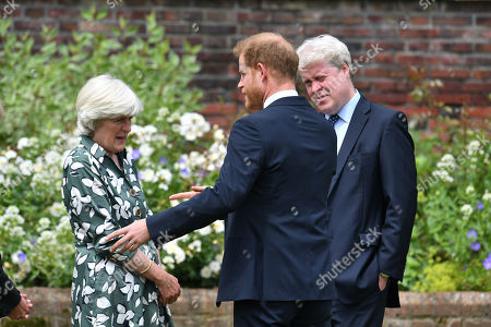Prince William (centre) with his aunt Lady Jane Fellowes and uncle Earl Spencer, at the unveiling of a statue of his mother Diana, Princess of Wales, in the Sunken Garden at Kensington Palace, London, on what would have been her 60th birthday