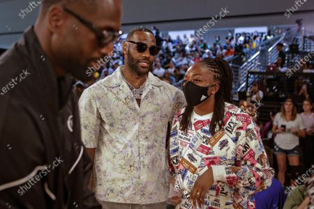 LeBron James talks with Nneka Ogwumike as Dwyane Wade passes by while attending a Los Angeles Sparks WNBA game on Wednesday, June 30, 2021 in Los Angeles, CA. (Jason Armond / Los Angeles Times)