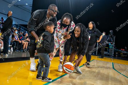 Stock Picture of Nneka and Chiney Ogwumike, players on the Sparks, give Dwayne Wade's daughter Kaavia a ball to play with during half time on Wednesday, June 30, 2021 in Los Angeles, CA. (Jason Armond / Los Angeles Times)