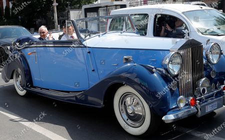 Lieutenant-General Ion Dobran, 102, former fighter pilot in the Romanian Army in WWII arrives, in a 1947 Rolls-Royce Silver Wraith limousine, for the inauguration ceremony of the mural 'Icarus Metamorphosis' by Romanian artist Obie Platon, realised in honor of Dobran in Bucharest, Romania, 01 July 2021. The mural, painted on a wall of a hotel, was designed in honor of veteran Ion Dobran, the last surviving WWII fighter pilot, and it symbolizes the air battle of June 06, 1944. In that air battle, US pilot Barrie Davis, a dogfight expert at the helm of a Mustang P51 war plane, was shot down by Romanian lieutenant Ion Dobran, who was flying a Messerschmitt Bf-109 fighter plane. Barrie Davis escaped with his life due to the way Dobran chose to attack, and thanked him for his gesture 66 years later, when the two fighters met at the Aviation Museum in Bucharest. Barry Davis died on August 19, 2014, at the age of 90. The mural depicts the two pilots that are symbolized by two Icarus characters, fighting in the air.