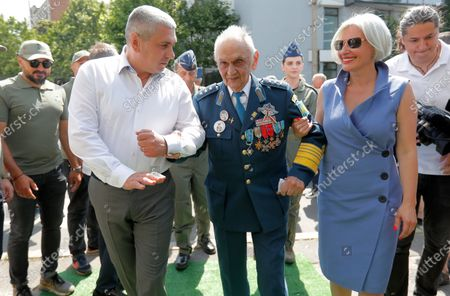Lieutenant-General Ion Dobran (C), 102, former fighter pilot in the Romanian Army in WWII arrives for the inauguration ceremony of the mural 'Icarus Metamorphosis' by Romanian artist Obie Platon, realised in honor of Dobran in Bucharest, Romania, 01 July 2021. The mural, painted on a wall of a hotel, was designed in honor of veteran Ion Dobran, the last surviving WWII fighter pilot, and it symbolizes the air battle of June 06, 1944. In that air battle, US pilot Barrie Davis, a dogfight expert at the helm of a Mustang P51 war plane, was shot down by Romanian lieutenant Ion Dobran, who was flying a Messerschmitt Bf-109 fighter plane. Barrie Davis escaped with his life due to the way Dobran chose to attack, and thanked him for his gesture 66 years later, when the two fighters met at the Aviation Museum in Bucharest. Barry Davis died on August 19, 2014, at the age of 90. The mural depicts the two pilots that are symbolized by two Icarus characters, fighting in the air.
