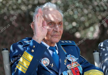 Lieutenant-General Ion Dobran, 102, former fighter pilot in the Romanian Army in WWII salutes the audience during the inauguration ceremony of the mural 'Icarus Metamorphosis' by Romanian artist Obie Platon, realised in honor of Dobran in Bucharest, Romania, 01 July 2021. The mural, painted on a wall of a hotel, was designed in honor of veteran Ion Dobran, the last surviving WWII fighter pilot, and it symbolizes the air battle of June 06, 1944. In that air battle, US pilot Barrie Davis, a dogfight expert at the helm of a Mustang P51 war plane, was shot down by Romanian lieutenant Ion Dobran, who was flying a Messerschmitt Bf-109 fighter plane. Barrie Davis escaped with his life due to the way Dobran chose to attack, and thanked him for his gesture 66 years later, when the two fighters met at the Aviation Museum in Bucharest. Barry Davis died on August 19, 2014, at the age of 90. The mural depicts the two pilots that are symbolized by two Icarus characters, fighting in the air.