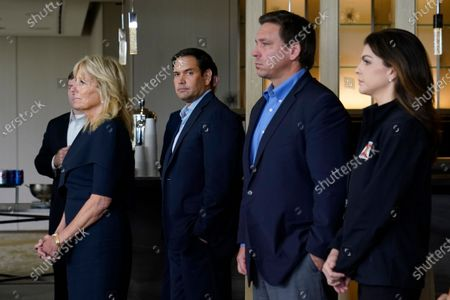 First lady Jill Biden, left, Sen. Marco Rubio, R-Fla., Florida Gov. Ron DeSantis and his wife Casey DeSantis, listen as President Joe Biden meets with first responders in Miami Beach, Fla., who were working on the condo tower that collapsed in Surfside, Fla., last week