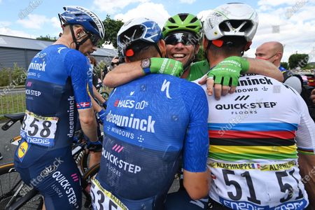 British rider Mark Cavendish of the Deceuninck Quick-Step team (2-R) celebrates with teammates French rider Julian Alaphilippe (R), Italain rider Davide Ballerini (2-L) and Danish rider Michael Morkov (L) after winning the 6th stage of the Tour de France 2021 over 160.6 km from Tours to Chateauroux, France, 01 July 2021.